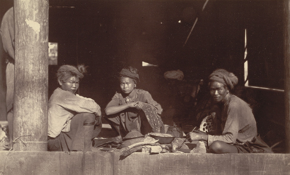 Another group of Kaychins. They were preparing their food in a wooden zyat or rest-house outside Bhamo